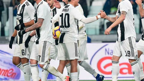 <p>               Juventus's Leonardo Bonucci, right, celebrates with teammate Paulo Dybala after scoring during the Serie A soccer match between Juventus and Frosinone at the Allianz Stadium in Turin, Italy,  Friday, Feb. 15, 2019. (Alessandro Di Marco/ANSA via AP)             </p>
