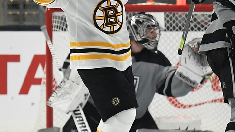 <p>               Boston Bruins left wing Brad Marchand, left, celebrates after scoring on Los Angeles Kings goaltender Jack Campbell during the second period of an NHL hockey game Saturday, Feb. 16, 2019, in Los Angeles. (AP Photo/Mark J. Terrill)             </p>