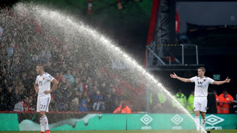 <p>               Wolverhampton Wanderers' Ryan Bennett reacts as the sprinkler unexpectedly comes on during the game against Bournemouth, during their English Premier League soccer match at the Vitality Stadium in Bournemouth, England, Saturday February 23, 2019. (John Walton/PA via AP)             </p>
