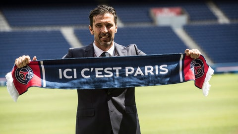 """<p>               FILE - In this Monday, July 9, 2018 file photo, PSG's new signing goalkeeper Gianluigi Buffon displays a scarf reading """"Here is Paris"""" during his official presentation at the Parc des Princes stadium in Paris, France. Speaking at a news conference on Saturday Feb. 2, 2019, Gianluigi Buffon said he wants to stay at Paris Saint-Germain next season, so long as his goalkeeping rival Alphonse Areola doesn't mind. (AP Photo/Jean-Francois Badias, File)             </p>"""