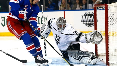 <p>               Los Angeles Kings goaltender Jonathan Quick (32) defends against New York Rangers center Filip Chytil (72) during the second period of an NHL hockey game, Monday, Feb. 4, 2019, in New York. (AP Photo/Noah K. Murray)             </p>