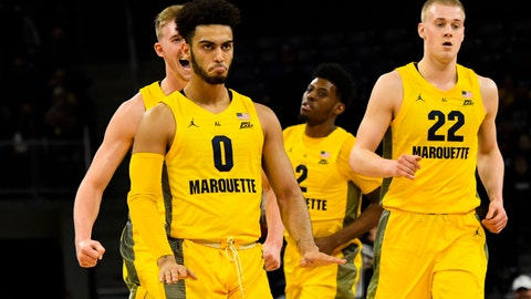 <p>               Marquette guard Markus Howard (0) reacts with teammates after scoring a three-point basket against DePaul during the first half of an NCAA college basketball game on Tuesday, Feb. 12, 2019. in Chicago, Ill. (AP Photo/Matt Marton)             </p>