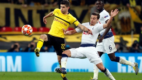 <p>               Tottenham midfielder Harry Winks fights for the ball with Dortmund midfielder Christian Pulisic, left, during the Champions League round of 16, first leg, soccer match between Tottenham Hotspur and Borussia Dortmund at Wembley stadium in London, Wednesday, Feb. 13, 2019. (AP Photo/Alastair Grant)             </p>