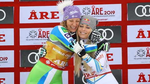 <p>               Slovenia's Ilka Stuhec, left, celebrates on the podium with third placed United States' Lindsey Vonn after winning the women's downhill race, at the alpine ski World Championships in Are, Sweden, Sunday, Feb. 10, 2019. (AP Photo/Marco Trovati)             </p>