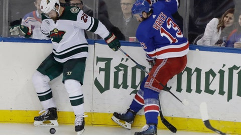 <p>               Minnesota Wild's Greg Pateryn (29) fights for control of the puck with New York Rangers' Kevin Hayes (13) during the third period of an NHL hockey game Thursday, Feb. 21, 2019, in New York. The Wild won 4-1. (AP Photo/Frank Franklin II)             </p>