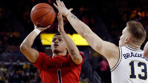 <p>               Maryland guard Anthony Cowan Jr. (1) shoots as Michigan forward Ignas Brazdeikis (13) defends during the first half of an NCAA college basketball game, Saturday, Feb. 16, 2019, in Ann Arbor, Mich. (AP Photo/Carlos Osorio)             </p>