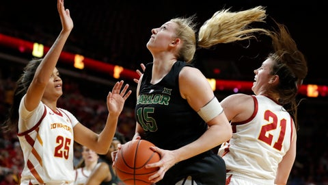 <p>               Baylor forward Lauren Cox, center, drives to the basket between Iowa State's Kristin Scott, left, and Bridget Carleton, right, during the first half of an NCAA college basketball game, Saturday, Feb. 23, 2019, in Ames, Iowa. (AP Photo/Charlie Neibergall)             </p>