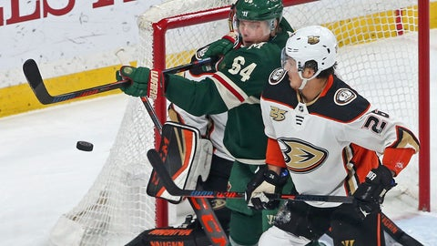 <p>               Minnesota Wild's Mikael Granlund, left, of Finland, tries to bat down the puck on a wide shot as Anaheim Ducks' Brandon Montour defends in the first period of an NHL hockey game Tuesday, Feb.19, 2019, in St. Paul, Minn. (AP Photo/Jim Mone)             </p>