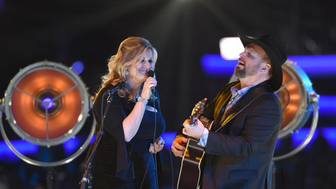 "<p>               Trisha Yearwood, left, and Garth Brooks perform ""Old Flames Can't Hold a Candle To You"" at MusiCares Person of the Year honoring Dolly Parton on Friday, Feb. 8, 2018, at the Los Angeles Convention Center. (Photo by Chris Pizzello/Invision/AP)             </p>"