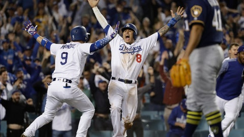 <p>               FILE - In this Oct. 16, 2018, file photo, Los Angeles Dodgers' Manny Machado (8) reacts after scoring on a Cody Bellinger walk-off hit during the 13th inning of Game 4 of the National League Championship Series baseball game against the Milwaukee Brewers, in Los Angeles. A person familiar with the negotiations tells The Associated Press that infielder Manny Machado has agreed to a $300 million, 10-year deal with the rebuilding San Diego Padres, the biggest contract ever for a free agent. The person spoke to the AP on condition of anonymity Tuesday, Feb. 19, 2019,  because the agreement was subject to a successful physical and had not been announced. (AP Photo/Matt Slocum, File)             </p>