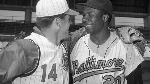 <p>               FILE - In this April 1, 1966, file photo, Cincinnati Reds' Pete Rose, left, greets Baltimore Orioles' Frank Robinson before a spring training baseball game, in Tampa, Fla. Hall of Famer Frank Robinson, the first black manager in Major League Baseball and the only player to win the MVP award in both leagues, has died. He was 83. Robinson had been in hospice care at his home in Bel Air. MLB confirmed his death Thursday, Feb. 7, 2019. (AP Photo/Paul Shane, File)             </p>