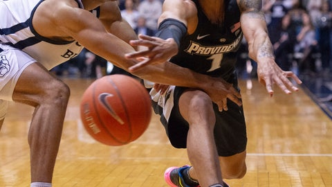 <p>               Providence guard Makai Ashton-Langford (1) makes a pass to a teammate around the defense of Butler guard Aaron Thompson (2) during the second half of an NCAA college basketball game, Tuesday, Feb. 26, 2019, in Indianapolis. Providence won 73-67. (AP Photo/Doug McSchooler)             </p>