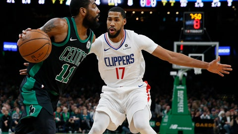<p>               Boston Celtics' Kyrie Irving (11) drives past Los Angeles Clippers' Garrett Temple (17) during the first half of an NBA basketball game in Boston, Saturday, Feb. 9, 2019. (AP Photo/Michael Dwyer)             </p>