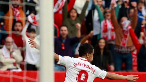 <p>               Sevilla's Wissam Ben Yedder celebrates after scoring his side's opening goal during the Europa League round of 32 second leg soccer match between Sevilla and Lazio at the Sanchez Pizjuan stadium, in Seville, Spain, Wednesday, Feb. 20, 2019. (AP Photo/Miguel Morenatti)             </p>
