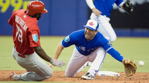 <p>               FILE - In this March 26, 2018, file photo, St. Louis Cardinals' Randy Arozarena, left, slides in with a stolen base as the ball gets past Toronto Blue Jays second baseman Danny Espinosa during fifth-inning spring training baseball game action in Montreal. Espinosa and the New York Mets have agreed to a minor league contract with an invitation to spring training. (Ryan Remiorz/The Canadian Press via AP, File)             </p>