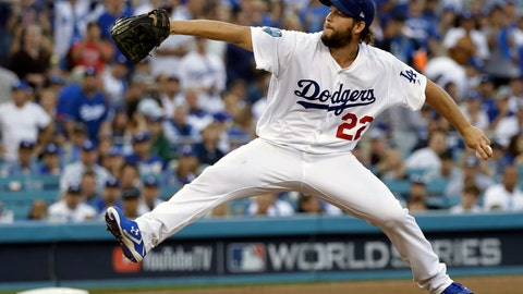 """<p>               FILE - In this Oct. 28, 2018, file photo, Los Angeles Dodgers pitcher Clayton Kershaw winds up during the first inning in Game 5 of the World Series baseball game against the Boston Red Sox in Los Angeles. Kershaw has been shut down indefinitely because manager Dave Roberts says the Dodgers ace """"didn't feel right"""" after two discouraging outings on the mound. Kershaw worked out indoors Friday, Feb. 22, 2019, at Camelback Ranch, but did not play catch.  (AP Photo/David J. Phillip, File)             </p>"""