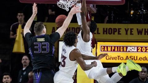 <p>               Arizona State's Luguentz Dort (0) dunks next to Washington's Sam Timmins (33) and his Arizona State's Romello White (23) during the first half of an NCAA college basketball game Saturday, Feb. 9, 2019, in Tempe, Ariz. (AP Photo/Darryl Webb)             </p>