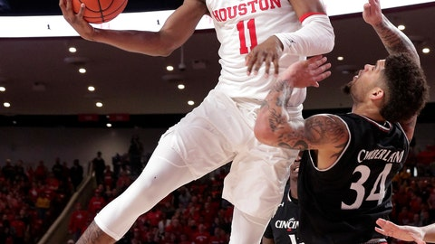 <p>               Houston guard Nate Hinton (11) jumps to shoot over Cincinnati guard Jarron Cumberland (34) during the second half of an NCAA college basketball game Sunday, Feb. 10, 2019, in Houston. (AP Photo/Michael Wyke)             </p>