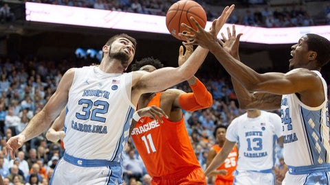 <p>               North Carolina's Luke Maye (32) and Kenny Williams (24), and Syracuse's Oshae Brissett (11) battle for a rebound during the first half of an NCAA college basketball game in Chapel Hill, N.C., Tuesday, Feb. 26, 2019. (AP Photo/Ben McKeown)             </p>