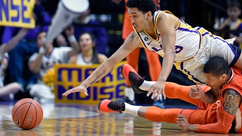 <p>               LSU guard Tremont Waters (3) dives over Auburn guard Samir Doughty (10) while going for a loose ball in the first half of an NCAA college basketball game, Saturday, Feb. 9, 2019, in Baton Rouge, La. (AP Photo/Bill Feig)             </p>