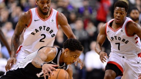 <p>               San Antonio Spurs guard DeMar DeRozan (10) loses the the ball under pressure from Toronto Raptors forward Kawhi Leonard (2) with about 15 seconds left in an NBA basketball game Friday, Feb. 22, 2019, in Toronto. (Frank Gunn/The Canadian Press via AP)             </p>