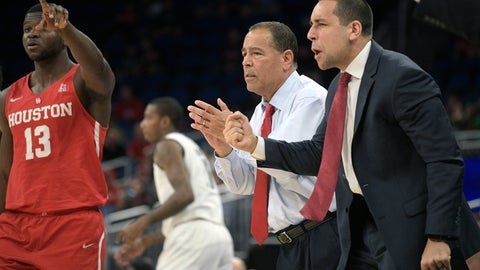 <p>               FILE - In this March 11, 2018, file photo, Houston head coach Kelvin Sampson and assistant coach Kellen Sampson, right, celebrate after a score during the first half of an NCAA college basketball championship game against Cincinnati, at the American Athletic Conference tournament, in Orlando, Fla. The entire team piles into coach Sampson's house before each home game to prepare for the next opponent, eat his wife Karen's delicious homemade chocolate chip cookies and bond like a family. The routine is something Sampson and his players agree has created an environment of closeness and trust that is an integral ingredient in the ninth-ranked Cougars' success this season. (AP Photo/Phelan M. Ebenhack, File)             </p>