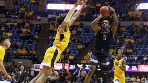 <p>               Kansas State guard Barry Brown Jr. (5) shoots while defended by West Virginia forward Emmitt Matthews Jr. (11) during the first half of an NCAA college basketball game Monday, Feb. 18, 2019, in Morgantown, W.Va. (AP Photo/Raymond Thompson)             </p>