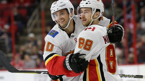 <p>               Calgary Flames' Derek Ryan (10) is congratulated by Andrew Mangiapane (88) after his goal against the Carolina Hurricanes during the second period of an NHL hockey game in Raleigh, N.C., Sunday, Feb. 3, 2019. (AP Photo/Gerry Broome)             </p>