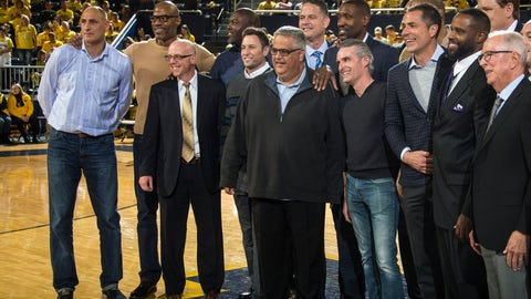<p>               Members of the 1989 Michigan basketball team and their coach Steve Fisher, far right, pose for a photo at the half of an NCAA college basketball game between Michigan and Michigan State at Crisler Center in Ann Arbor, Mich., Sunday, Feb. 24, 2019. (AP Photo/Tony Ding)             </p>