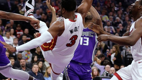 <p>               Miami Heat guard Dwyane Wade falls during the first quarter of the team's NBA basketball game against the Sacramento Kings on Friday, Feb. 8, 2019, in Sacramento, Calif. (AP Photo/Rich Pedroncelli)             </p>