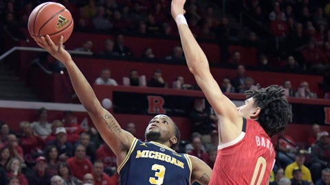 <p>               Michigan guard Zavier Simpson (3) shoots as Rutgers guard Geo Baker (0) defends during the first half of an NCAA college basketball game Tuesday, Feb. 5, 2019, in Piscataway, N.J. (AP Photo/Bill Kostroun)             </p>