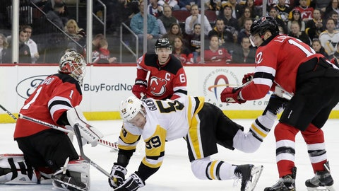 <p>               Pittsburgh Penguins left wing Jake Guentzel (59) falls to the ice while attacking against New Jersey Devils goaltender Keith Kinkaid (1), defenseman Andy Greene (6) and defenseman Ben Lovejoy (12) during the third period of an NHL hockey game, Tuesday, Feb. 19, 2019, in Newark, N.J. The Penguins won 4-3. (AP Photo/Julio Cortez)             </p>