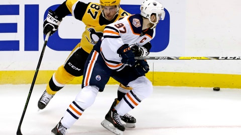 <p>               Pittsburgh Penguins' Sidney Crosby (87) defends against Edmonton Oilers' Connor McDavid (97) during the first period of an NHL hockey game in Pittsburgh, Wednesday, Feb. 13, 2019. (AP Photo/Gene J. Puskar)             </p>