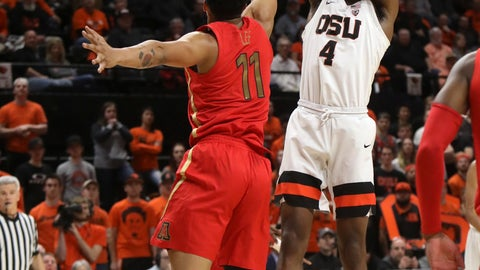 <p>               Oregon State's Alfred Hollins (4) takes a shot despite defense from Arizona's Ira Lee (11) during the first half of an NCAA college basketball game in Corvallis, Ore., Thursday, Feb. 28, 2019. (AP Photo/Amanda Loman)             </p>