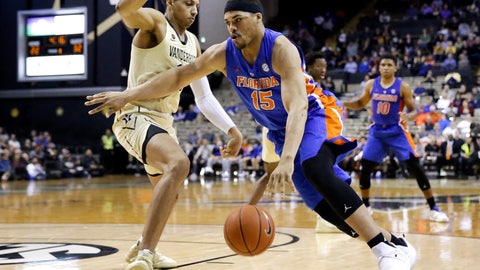 <p>               Florida forward Isaiah Stokes (15) drives against Vanderbilt forward Matthew Moyer in the first half of an NCAA college basketball game Wednesday, Feb. 27, 2019, in Nashville, Tenn. (AP Photo/Mark Humphrey)             </p>