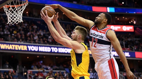<p>               Indiana Pacers forward Domantas Sabonis, left, goes to the basket against Washington Wizards forward Jabari Parker (12) during the first half of an NBA basketball game Saturday, Feb. 23, 2019, in Washington. (AP Photo/Nick Wass)             </p>