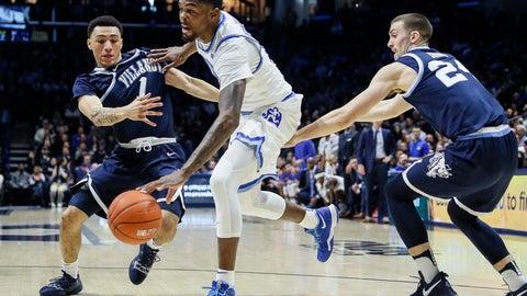 <p>               Xavier's Naji Marshall, center, drives against Villanova's Jahvon Quinerly (1) in the first half of an NCAA college basketball game, Sunday, Feb. 24, 2019, in Cincinnati. (AP Photo/John Minchillo)             </p>