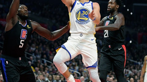 """<p>               FILE - In this Jan. 18, 2019, file photo, Golden State Warriors guard Stephen Curry, center, shoots as Los Angeles Clippers forward Montrezl Harrell, left, and guard Patrick Beverley defend during the second half of an NBA basketball game, in Los Angeles. Golden State is still the favorite for a fourth title in five years.c """"Every year is a new challenge, different circumstances,"""" Golden State guard Stephen Curry said. """"We are motivated. We understand what's at stake."""" (AP Photo/Mark J. Terrill, File)             </p>"""