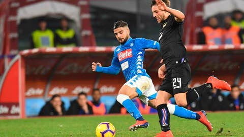<p>               Napoli's Lorenzo Insigne, left, and Sampdoria's Bartosz Bereszynski go for the ball during the Serie A soccer match between Napoli and Sampdoria at the San Paolo stadium in Naples, Italy, Saturday, Feb. 2, 2019. (Ciro Fusco/ANSA via AP)             </p>