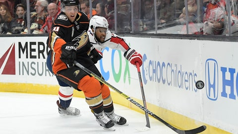 <p>               Anaheim Ducks defenseman Cam Fowler, left and Washington Capitals right wing Devante Smith-Pelly vie for the puck during the first period of an NHL hockey game Sunday, Feb. 17, 2019, in Anaheim, Calif. (AP Photo/Mark J. Terrill)             </p>