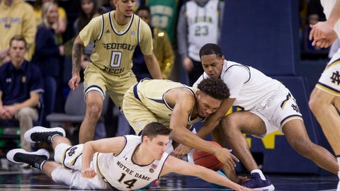 <p>               Notre Dame's Nate Laszewski (14) and D.J. Harvey, right, compete for a loose ball with Georgia Tech's James Banks III, center, during the first half of an NCAA college basketball game Sunday, Feb. 10, 2019, in South Bend, Ind. (AP Photo/Robert Franklin)             </p>