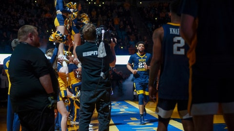 <p>               West Virginia Mountaineers forward Esa Ahmad (23) joins his teammates on the court during team introductions before an NCAA college basketball game against the University of Texas Longhorns in Morgantown, W.Va. on Saturday Feb. 9, 2019. (AP Photo/Craig Hudson)             </p>