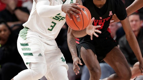 <p>               South Florida guard LaQuincy Rideau, left, looks to pass the ball as Houston guard Dejon Jarreau, right, during the second half of an NCAA college basketball game Saturday, Feb. 23, 2019, in Houston. (AP Photo/Michael Wyke)             </p>