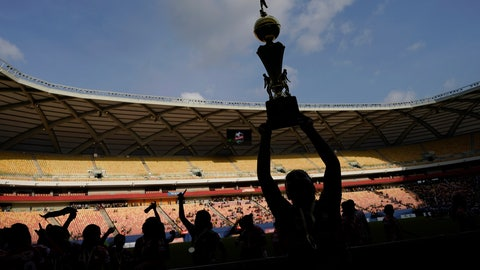 <p>               Salcomp players celebrate with their trophy after winning the Peladao amateur soccer tournament at Arena da Amazonia in Manaus, Brazil, Saturday, Feb. 16, 2019. Despite many of the players having worked a full 8-hour shift at a factory before the game, the female team went on to win one of the biggest amateur soccer tournaments on the planet. (AP Photo/Victor R. Caivano)             </p>