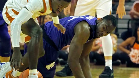 <p>               Texas guard Courtney Ramey, left, fights for the loose ball with Kansas State forward Makol Mawien, right, during the first half of an NCAA college basketball game, Tuesday, Feb. 12, 2019, in Austin, Texas. (AP Photo/Michael Thomas)             </p>