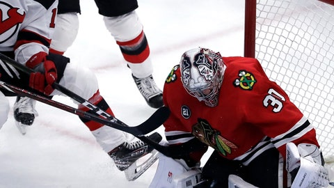 <p>               Chicago Blackhawks goalie Cam Ward, right, blocks a shot by New Jersey Devils center Nico Hischier during the first period of an NHL hockey game Thursday, Feb. 14, 2019, in Chicago. (AP Photo/Nam Y. Huh)             </p>