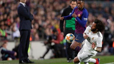 <p>               Real defender Marcelo, right, duels for the ball with Barcelona defender Nelson Semedo during the Copa del Rey semifinal first leg soccer match between FC Barcelona and Real Madrid at the Camp Nou stadium in Barcelona, Spain, Wednesday Feb. 6, 2019. (AP Photo/Manu Fernandez)             </p>