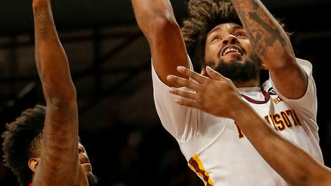 <p>               Minnesota's Jordan Murphy (3) shoots as he is fouled by Indiana's Juwan Morgan, right, as De'Ron Davis, left, helps to defend in the first half of an NCAA college basketball game Saturday, Feb. 16, 2019, in Minneapolis. (AP Photo/Bruce Kluckhohn)             </p>