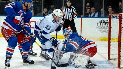 <p>               New York Rangers goalie Alexander Georgiev deflects a shot by Tampa Bay Lightning's Brayden Point during the first period of an NHL hockey game Wednesday, Feb. 27, 2019, at Madison Square Garden in New York. At letf is New York Rangers Fredrik Claesson. (AP Photo/Craig Ruttle)             </p>