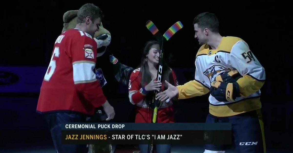 c7dee1a2348 Panthers captain Aleksander Barkov and Predators captain Roman Josi  exchange sticks with Jazz Jennings for Pride Night